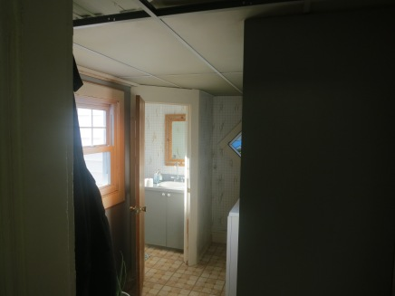 The terrible drop ceiling before it was removed.