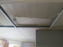 The ceiling during drop ceiling removal.